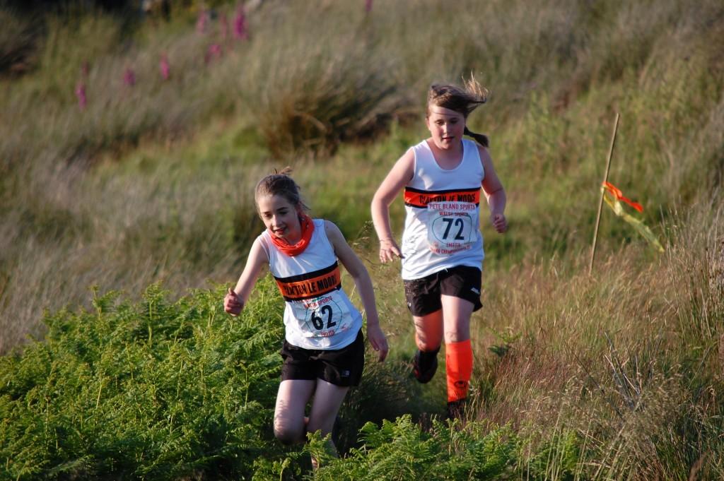 Keira Stevenson and Bronia Olszewska in the Under 12s Race at Widdop. Photo by Nick Olszewski