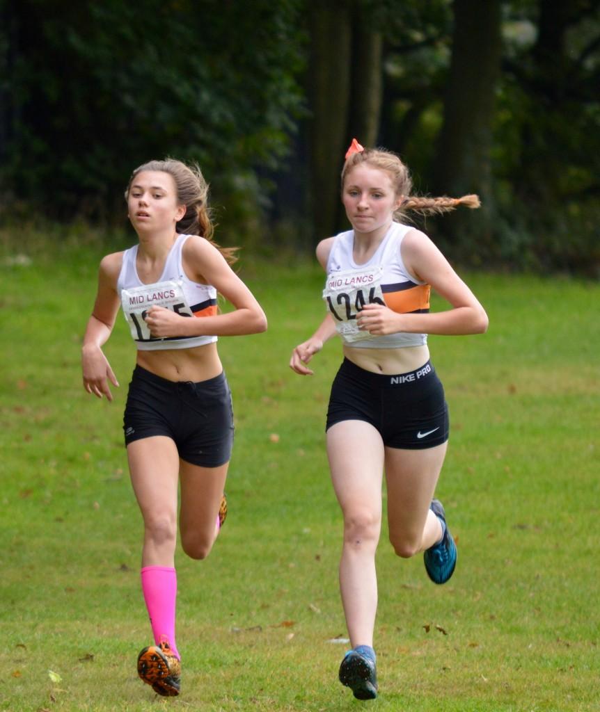 Millie Stubbs and Liberty Thompson in the U13 Girls race. Photo by Nicholas Olszewski