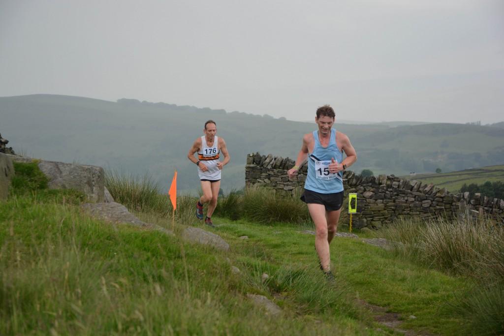 Ivan Whigham chasing Rossendale Harrier Mick Toman