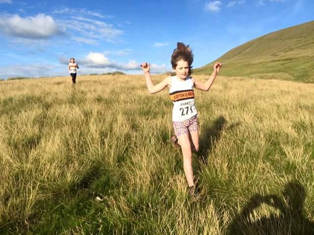 Rachel Stevenson chased by Ellisia Smedley at the U8/U10 Race. Photo by Alan Dorrington