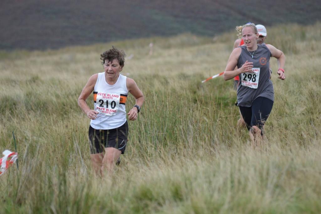 Sarah Helliwell chasing Katy Thompson at the Pendleton Fell Race. Photo by Nicholas Olszewski