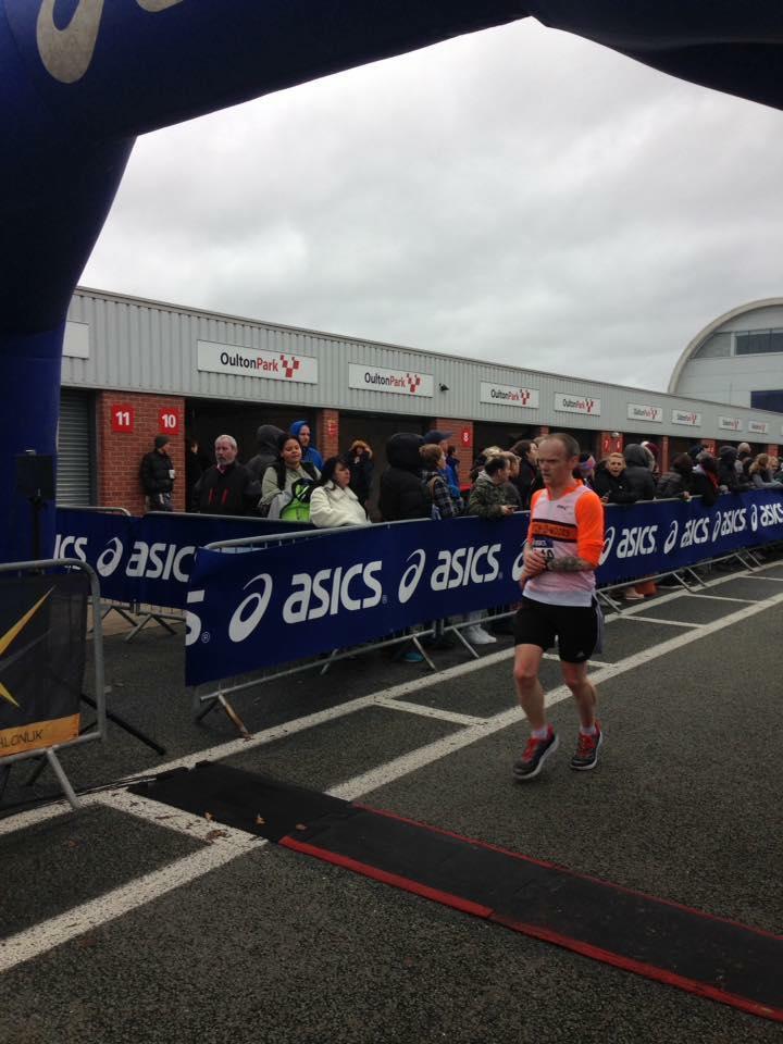 Jon Cleaver at the finish line of the Oulton Park Half Marathon