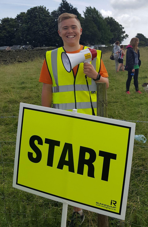 Junior Aaron Lundie helping to organise Worsthorne Moor Trail Race. Photo by Deborah Stevenson